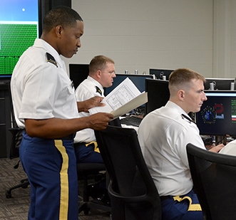Cyber Soldiers doing cyberspace operations.