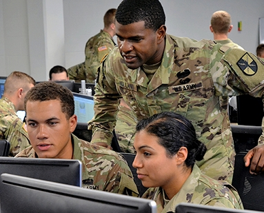 Cyber Command Officers examine data.