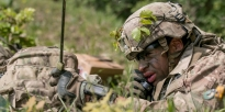 U.S. Army Cavalry Scout using radio.