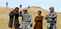 Army soldiers gather intel from an Afghani farmer
