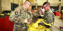 Soldiers working on equipment.