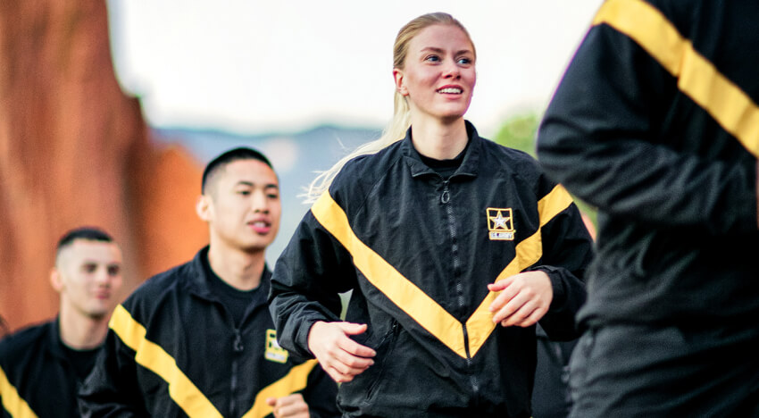 Female and male Soldiers happily running in Army athletic gear in physical training.