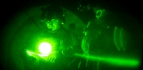 night vision view of soldier reviewing map